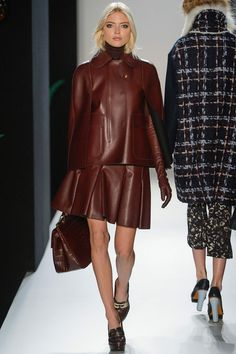 #LFW #FW2013 #RTW  Wine color again in leather. Pleated skirt with a leather cape. Wine leather EVERYTHING!!
