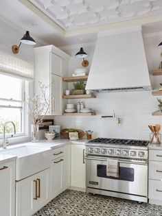 Beautiful, simple, modern kitchen! The white oak shelves go perfectly with the white and light theme.
