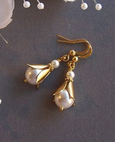 White Pearl Gold Earrings Gold Filled Vermeil and by lecollezione, $21.00