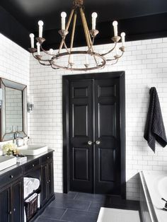Easy Door Update in Timeless Black and White Master Bathroom Makeover from HGTV closet door idea Black And White Master Bathroom, Black White Bathrooms, Bathroom Black, Black Cabinets Bathroom, Bad Inspiration, Bathroom Inspiration, Bathroom Ideas, Men's Bathroom, Houzz Bathroom