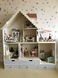 """Decorated Barbie DIY wooden Martin Dollhouse Country Kit.    """"We purchased the kit last December after a long search for a quality dollhouse. I built the house after last Christmas. This fall, I just felt that this had to get done before the upcoming Christmas. I did not want to rush with the wallpaper and wall trim, so I'll take a break until January and finish it then. My daughter loves it!!!"""""""
