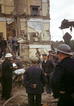 London, 1940-A Civil Defense Crew helps remove dead civilians after a German bombing raid.