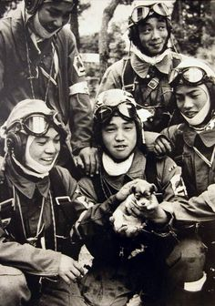 Japanese pilots and puppy. 1945.