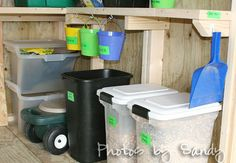 Garden shed.Containers with green labeled duct tape and seals for potting soil. I like this idea instead of having bags laying around. Easier to use as well!