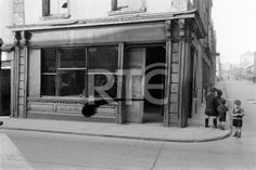 Young boys at the corner of North King Street (left) and Coleraine Street, Dublin city, in 1952 or 1953. They are standing outside furniture dealer Henry McBride's premises at 31 North King Street. *Note the area of negative damage visible in the centre of frame.* Collection RTÉ Johnson Collection Photographer Johnson, Nevill
