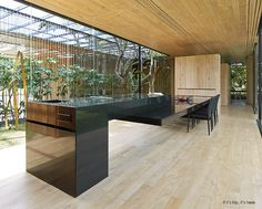 The INOUT House in Costa Rica by Joan Puigcorbé will wow you with its expansive horizontal floor plan and giant glass panes that bring the outdoors inside.