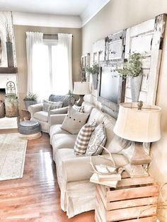 Farmhouse living room! IKEA curtains and couch with chippy doors. IG @bless_this_nest http://mrspals.com/?product_tag=60s-triangles