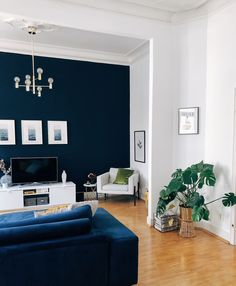 A Rental Apartment in Germany is a Gorgeous Mix of Mid-Century Modern, Boho, and Scandinavian - Gorgeous Architectural German Apartment Photos Blue Walls Living Room, Living Room Accents, Navy Living Rooms, Living Room Wall, House Interior, Home, Blue Living Room Decor, Interior, Home And Living