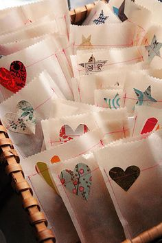 Sew on paper shapes for a nice touch! | 13 Beautifully Easy Gift Wrapping Ideas