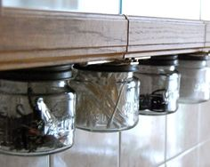 This is a great idea! Magnetic strip under bathroom counter.
