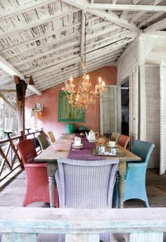 colored wicker chairs on beach patio. L.O.V.E.