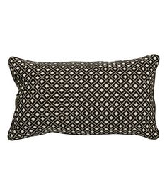 $10  Cushion cover with a front section in jacquard-weave, cotton-blend fabric and back section in solid-color cotton fabric. Piping at edges and concealed zip. Size 16 x 28 in.