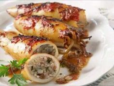 Calamari gemisto recipe a wonderfully delicious dish and is often eaten during the Greek Orthodox Lent when squid, olive oil, and wine are permitted Calamari Recipes, Squid Recipes, Fish Recipes, Seafood Recipes, Cooking Recipes, Seafood Dishes, Fish And Seafood, Greek Recipes, Italian Recipes