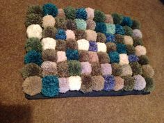 My 1st lovely pompom rug  Ta da made it- never again :/