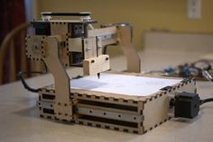ShapeOko is a dead simple Open-Source desktop CNC machine with an estimate build price of about $300. Get into CNC without going broke!