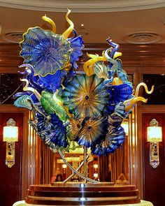 Chihuly. I've seen some of his chandeliers in person and they are STUNNING. Truly breathtaking.