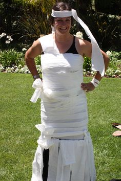 HAHAHAHA. And now, for the part of the classy shower in which I turn all of you into mummies! bridal shower - bridal shower games - toilet paper bridal gown contest