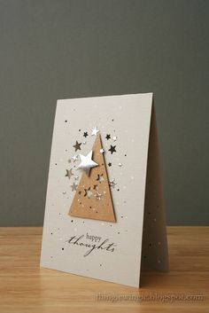 What a simple sparkly card! A tree shape cut from kraft paper, with some small stars punched out of it, really pops on this white card. Silver and gold stickers or punches add the holiday spirit to this handmade Christmas card. Homemade Christmas Cards, Homemade Cards, Handmade Christmas, Simple Christmas, Christmas Stickers, Xmas Cards, Diy Cards, Holiday Cards, Winter Karten