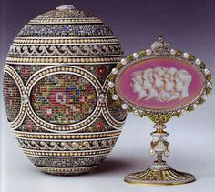 The Faberge Mosaic Egg ~ Czarina Alexandra Fyodorovna. The surprise is a jewelled and enamelled miniature frame painted with the profiles in camaieu brun of the five Imperial children on an opalescent pink enamel ground surrounded by green enamel husk and pearls, surmounted by an Imperial crown set with rose diamonds..
