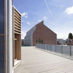 Image 6 of 29 from gallery of Sandal Magna Community Primary School / Sarah Wigglesworth Architects. Photograph by Mark Hadden Photography Dezeen Architecture, School Architecture, People In Space, School Building, Learning Centers, Architect Design, Primary School, Cladding, Places To Visit