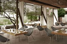 www.south-design.nl - Zulu mama chair in black at restaurant Singita Lebombo Lodge, South Africa - made of recycled plastic - handmade - sustainable design