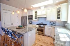 Clean, white kitchen! Not granite, quartzite counters are the new trend...
