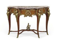 A FRENCH ORMOLU-MOUNTED KINGWOOD CONSOLE TABLE - ATTRIBUTED TO FRANCOIS LINKE, PARIS, LATE 19TH CENTURY.