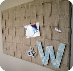 burlap pin board @Megan Ward Shires  hey girl...this is similar to the one i have just picture rows of twine hung across it with tiny clothes pins! perf for the wedding!