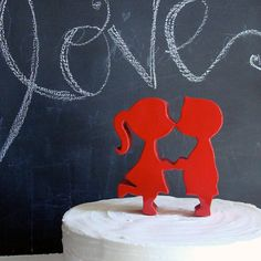 Cute! Cute! Cute! Kissing couple silhouette cake topper. (Look at her foot pop!)