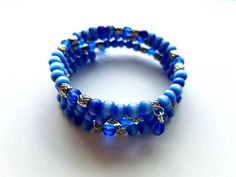 Hey, I found this really awesome Etsy listing at https://www.etsy.com/listing/471159294/memory-wire-bracelet-with-blue-crystal