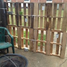 Backyard privacy fence I made from wood pallets...I feel like I could do better than this