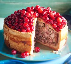 This raised pork, chicken and bacon pie, topped with festive fruit, makes for a magnificent centr