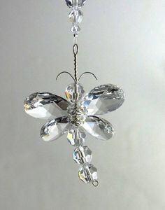 This beautiful Dragonfly suncatcher / car charm has been hand crafted from only Swarovski Crystal. The dragonfly has its own character, as it