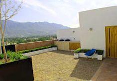 Terrazas de estilo  por Lozano Arquitectos
