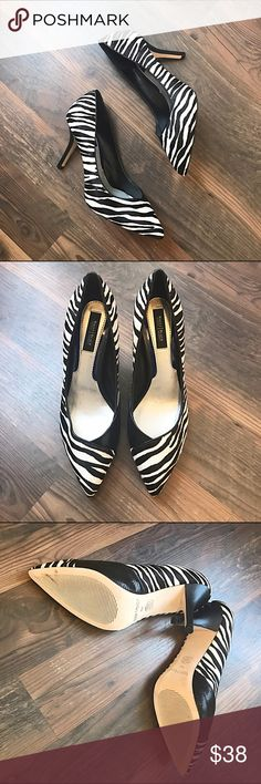 "Calf Hair WHBM Pumps Absolutely stunning calf hair zebra print pointed toe pumps from White House Black Market. They have a 3.5"" heel with a hidden .5"" platform.   Slight padding makes them super comfy. These were never worn outside and are in great shape. Bundle to save even more!! White House Black Market Shoes Heels"