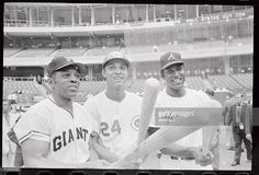 Big men in the National League do their thing for photographers here prior to the All Star Game. They are (LTR), Willie Mays, of the San Francisco Giants, Tony Perez, of the Cincinnati Reds, and Rico Carty of the Atlanta Braves.