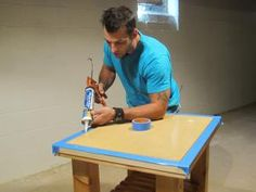 Marc adds silicone to the edges of the wood frame of the kitchen cart construction project. Laundry Cart, Building A Kitchen, Ping Pong Table, Kitchen Cart, Wood, Construction, Projects, Frame, Home Decor