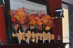 Fall decor with wine bottles.. maybe a different bow or no bow..