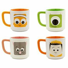 Disney/Pixar Mug Collection Set 1 | Disney StoreDisney/Pixar Mug Collection Set 1 - This set of mugs features the smiling mugs of four of Disney/Pixar's most popular characters. Stylized images of Mike Wazowski, Nemo, Remy and Russell are pictured on the cups, which have complementary colored interiors and handles.