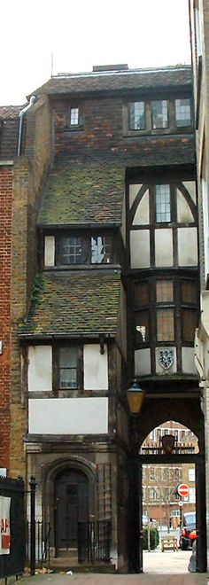 St Bartholomew's gatehouse that leads to the oldest parish church in London - St Bartholomew-the-Great - was built in the sixteenth century and is where Queen Mary ate chicken and drank red wine while watching Protestant martyrs burn at the stake. It was only when a first World War German Zeppelin bomb in 1916 fell nearby that the tiles to this arch fell off to reveal this Elizabethan half timber fronted house built in 1597. Rear view of the Elizabethan gate house.