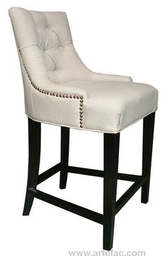 Royal and majestic looking tufted fabric bar/counter stool with antique brass nail head, comes in neutral linen fabric with black legs. Kiln dried solid hardwood frame, high density foam with Pirelli straps. Made for commercial and residential use.