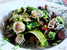 Barley orecchiette pasta with dried tomatoes, broccoli and olives - orecchiette d'orzo ai pomodori secchi, broccoli e olive taggiasche