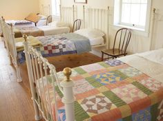 Love the antique quilts on these beds. Wonderful idea for a grandchildrens' room!