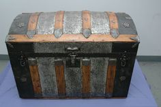 Antique dometop steamer trunk with stunning metal filigree work. Signed MAR patent date 1880. Original inserts.