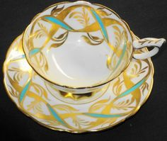 Royal Stafford England teacup and saucer, gold and aqua ribbon   Ebay.