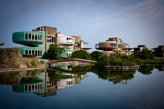 The Abandoned Sanzhi UFO Houses | These colorful flying saucer-style buildings, located in the Sanzhi district of New Taipei City in Taiwan, were built in 1978 but were forsaken before anyone ever stayed in them.