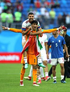 364a00cb318 Ramin Rezaeian of Iran celebrates victory with team mate Mohammad Reza  Khanzadeh at the end of