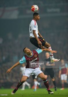 Manchester United's English striker Marcus Rashford (top) vies with West Ham United's New Zealand defender Winston Reid during the English Premier League football match between West Ham United and Manchester United at The Boleyn Ground in Upton Park, in east London on May 10, 2016. / AFP / GLYN KIRK / RESTRICTED TO EDITORIAL USE. No use with unauthorized audio, video, data, fixture lists, club/league logos or 'live' services. Online in-match use limited to 75 images, no video emulation. No…