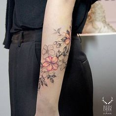 Floral forearm tattoo.