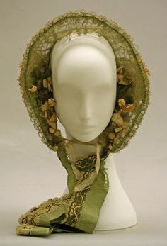 1858. Green bonnet with flowers.